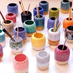 The Pen is hand-thrown in earthenware and dipped in various glazes before being fired. It's great for storing paint brushes, pens or even tooth brushes. Please