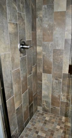 Verying planks have earthy stone looks that match the 2x2 mosaic on the floor