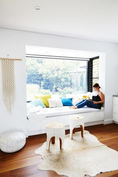 Home tour: Scandi minimalist style in a white and bright home with pops of color. Love this reading nook in he window seat! Photography by Cath Muscat. Styling by Vanessa Colyer Tay. From the February 2017 issue of Inside Out Magazine. Window Benches, Window Seats Bedroom, Bedroom Windows, Bright Homes, Luz Natural, Natural Light, Banquette, Home Decor Bedroom, Family Room