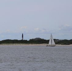 Sailboat And Oak Island Lighthouse by Cathy Lindsey Oak Island Lighthouse, Bald Head Island, Sailboat, San Francisco Skyline, Photos, Travel, Sailing Boat, Pictures, Viajes