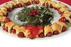 The Holidays Are a Perfect Time for Creative Bite-Sized Appetizers this lit'l wiener wreath is perfect!!