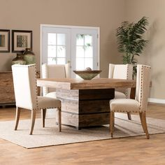 The Century Rustic Dining Room Set Features A Natural Pine Pedestal Table And Wing Back Chairs