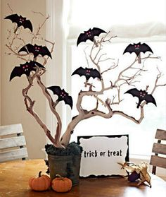 easy craft for the kids and cheap to do!! just get a branch, color it black if you would like, put some glue and sprinkle glitter. And then add the bats or ghosts on it.