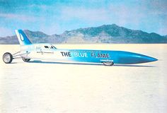 "American racing driver Gary Gabelich drove the aluminium bodied, rocket-powered ""Blue Flame"" (which used a combination of high-test peroxide and liquified natural gas (LNG), pressurized by helium), to 630.389 mph / 1014.52 km/h (m) 622.407 mph / 1001.67 km/h (km)on the Bonneville Salt Flats, Utah, USA (23 Oct 1970) to become the first person to drive faster than 1,000 km/h"