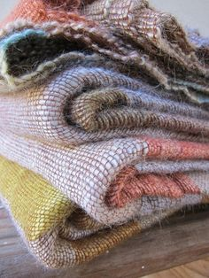 Folded blankets in soft shades woven in mohair