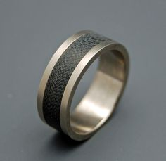 Titanium Wedding Ring, carbon fiber ring, Mens Rings, Womens Rings, Eco-Friendly Wedding Rings, Unique Wedding Rings, black ring - HEARTS by MinterandRichterDes on Etsy https://www.etsy.com/listing/61897806/titanium-wedding-ring-carbon-fiber-ring