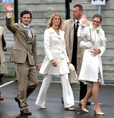 Siblings Prince Carl Philip, Princess Madeleine and Princess Victoria with a bodyguard