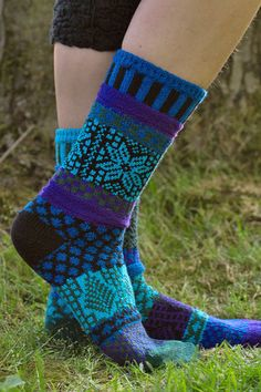 Part of Solmate's Winter Celebration Series, these socks are soul warming combination of black, forest green, purple, royal blue & tuquoise.
