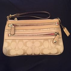 Authentic Coach Tri-Zip Wristlet Clutch Used only a couple times, perfect condition! Three zippered pockets, perfect for organizing while also keeping your hands/arms clear of a clunky purse! Two shades of beige are used for the classic coach pattern with a hot pink/coral lining inside Coach Bags Clutches & Wristlets