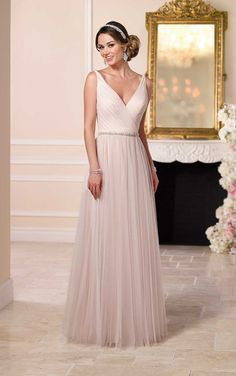 French tulle over matte-side lavish satin sheath bridal gown from the Stella York bridal gown collection features a plunging neckline, Diamante beaded waist belt, low back, and a flowing tulle skirt that falls gracefully into a pretty sweep train.  | Available at The Something Blue Shoppe, AL | www.TheSomethingBlueShoppe.com