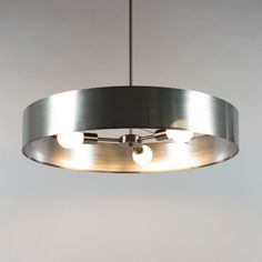 """$520 36"""" The retro yet modern Ziggy Chandelier features a Brushed Nickel finish with a variety of shade or cage options. Also available without a shade or cage. Choose from a three arm or five arm version. 100 watt max 120 volt medium base incandescent, CFL, or LED bulbs are required, but not included. 36 inch adjustable stem included. 3 arm version: 30 inch width x 5 inch height x 41 inch maximum length. 6 arm version: 36 inch width x 5 inch height x 41 inch maximum length. UL/ETL listed."""