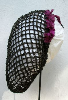 1860s beaded ribbon hairnet, trimmed with purple feathers