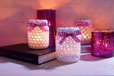 "Here comes the promised Winner Free Crochet Pattern from our new book ""Crochet Cute Minis"". We crochet lanterns or tealight glasses. Crochet Home, Free Crochet, Crochet Jar Covers, Nintendo Console, Candle Jars, Candles, Single Crochet Stitch, Helly Hansen, Tea Light Holder"