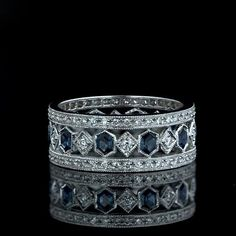 18 Karat white gold lacy eternity band glittering with sapphires and diamonds
