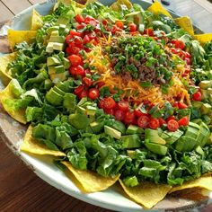 Who wants some?  The chips are Jackson Honest brand, made with coconut oil. The cheese is high quality, and meant to be used sparingly as a condiment. The taco meat is grass fed beef. Taco Salad for a Crowd Fresh Romaine Lettuce, torn into bite sized pieces Avocado, cubed Grape tomatoes, halved...