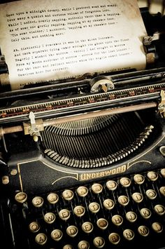 """Old Underwood typewriter, text of Edgar Allan Poe's """"The Raven"""" being typed out"""