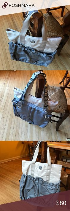 Lululemon Athletica yoga bag Never used. Large lululemon gym bag with several compartments. Silky grey and cream colored bag with removable shoulder strap. lululemon athletica Bags Travel Bags