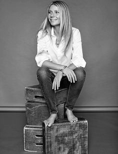 Keeping it casual, Gwyneth Paltrow poses in CH Carolina Herrera top, Reiko jeans and Tous jewelry