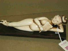 CHINESE IVORY CARVING | ... Auctioneers Image 1 CHINESE CARVED IVORY MEDICINE DOLL The recumbent