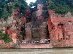 Leshan Giant Buddha, Sichuan, China...The famous 71 meters (233 feet) tall statue is carved out of a cliff face. It shows a seated Buddha with  his hands on his  knees. This statue  is the tallest statue of the Buddha and the shoulders are 28 meters wide.  The smallest toenail can easily seat a  person and the 7 meters wide ear can accommodate two people . The head of the Leshan Buddha is 14.7 meters tall and  10 meters wide and is covered with 1,021 buns of curly hair.