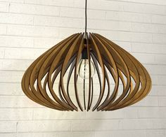 wood Pendant Light lasercut Chandelier lamp Handmade plywood hanging ceiling cup ecological minimal modern design industrial by AAarchiTECtureLab on Etsy https://www.etsy.com/listing/264558852/wood-pendant-light-lasercut-chandelier