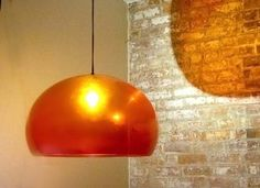 Orange Vintage Acrylic Dome Lamp is designed with a plastic material. This design was popular in the 1960′s or 70′s. still fits a  modern interior I think