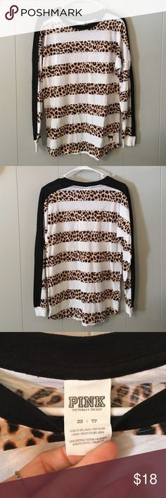 VS PINK striped cheetah long sleeve tee Victoria's Secret PINK long sleeve t shirt. White and cheetah stripes with black collar and down arm. Only worn once or twice. Great condition! PINK Victoria's Secret Tops Tees - Long Sleeve