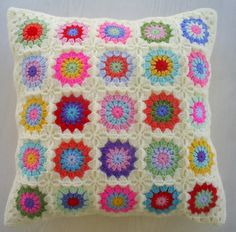 the colors in cream granny square cushion cover by handmadebyria