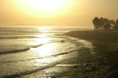 taken at Ventura, CA at sunset as a surfer was leaving the water