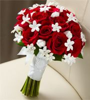 There's something about red roses and pure white stephanotis that makes me smile! :)