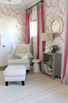Gorgeous pink and white nursery with floral wallpaper and modern accents, gray furniture