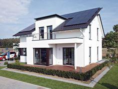 einfamilienhaus modern holzhaus satteldach flachdach mit gaube holzfassade modern eckfenster. Black Bedroom Furniture Sets. Home Design Ideas