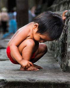 This reminds me of a boy about this age that was begging on some stairs in downtown Bangkok. He stood there the entire day.