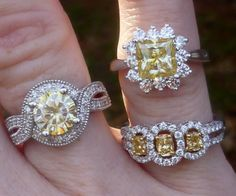 Top - 8mm round yellow moissy and 8mm Princess cut yellow moissyBottom - three stone natural canary diamond ring