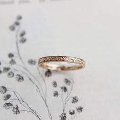 width Rose gold floral engraved ring shown here in UK size MThis ring is flat court shape meaning it is flat on the outside and slightly curved on the inside for. Alliance Or Rose, Cute Jewelry, Silver Jewelry, Gold Jewellery, Silver Bracelets, Jewlery, Engagement Ring Settings, Engagement Rings, White Gold Diamonds