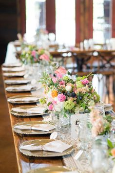 Rustic Wooden Farm Table Reception Seating with Floral Centerpieces | REBECCA ELLISON PHOTOGRAPHY | http://knot.ly/6491BFEMz