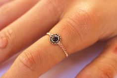 Halo engagement ring with black onyx and diamonds Engagement