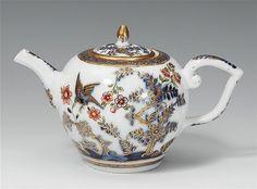 A Meissen porcelain teapot with bird and rock decor