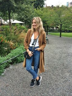 Camel coat with boyfriend jeans and sneakers