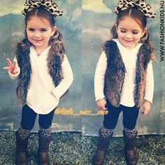 Girls fashion. Faux fur vest