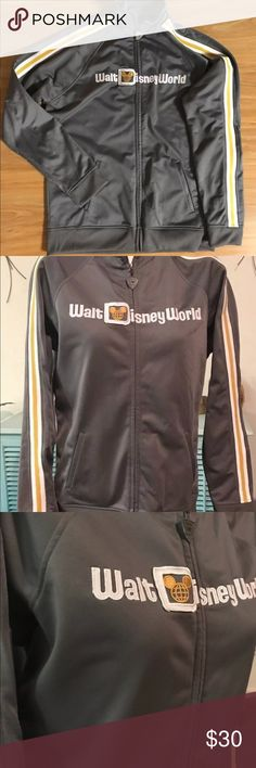 "Walt Disney World Vintage Style Track Jacket Walt Disney World 40th Anniversary Retro Style Track Jacket in EXCELLENT pre-owned condition. No stains, holes or loose threads. It is really beautiful. This is a unisex Large. The measurements for reference are:  22"" armpit to armpit measured laying flat 25"" shoulder to hem  This Jacket does not have traditional shoulder seams so an accurate measurement couldn't be made.  100% Polyester, polyester lining. This is warm, not light like a…"