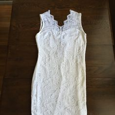 White Lace  fitted dress This dress is so pretty! The lace goes farther down than the lining and it gives it a beautiful detail below. I was going to wear this for a party and wore something else instead which is why I still have the tag on!! H&M Dresses Midi