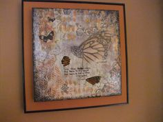 """""""Take These Broken Wings"""". Canvas mounted on wood panel with slightly raised edges (used for mixed media art). I painted the edges and sides with black acrylic paint.  I chose Bazzil cardstock as matting that matches colours on my canvas."""
