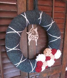 Colette yarn wreath, hand-wrapped Christmas wreath with felt flowers and reindeer, 14 in. $31.00, via Etsy.