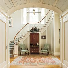 I might not care if the rest of the house was furnished if I had this entry hall and that swoopng staircase. Love the rug and stair carpet, chairs and secretary. But I wouldn't need that little framed whatever to the right of the secretary.