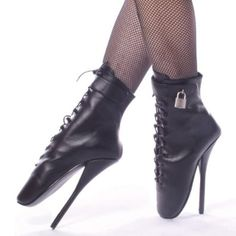 BDSM Leather Fetish 7 Inch Ballet Boot With Lock - 7. 7 inch spiked heel with a lace up front with a padlock on the side.  These are designer shoes, and are often narrower and tighter than usual. Take this into consideration when you choose your size, especially if you are half size. (these shoe are not for dancing)