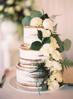 Semi-naked wedding cake with flowers. Credits in comment.