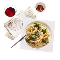 """The warm spaghetti in this dish """"cooks"""" the egg mixture to create a silky sauce, just like in a traditional carbonara recipe. Miso paste increases the umami factor and bright broccoli rabe brings freshness to the classic bacon, egg, and cheese combo."""