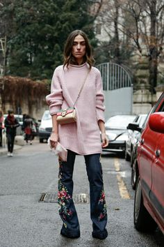 Pale pink oversized knit and embroidered denim.