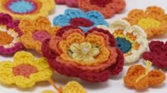 Aha!  These crocheted flowers could top the floral tea cozy!